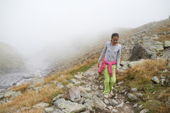 There is one girl walking in the mountains Stock Photo