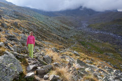 There is one girl walking in the mountains Royalty Free Stock Photography