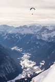 There is a paraglider over the mountains. In Val di Fassa valley Royalty Free Stock Images
