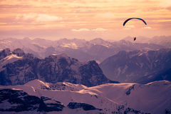 There is a paraglider over the mountains. In Val di Fassa valley Stock Photos