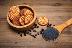 There are Pieces of  Roll with poppyseed,Cookies,Halavah,Chocolate Peas,Tasty Sweet Food on the Wooden Background Stock Photo
