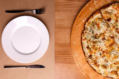 A whole pizza is served on the table stock photos