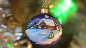Christmas decorations. Ball with a picture of a house stock video