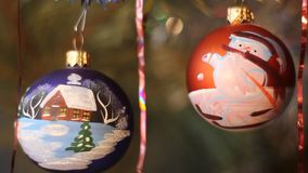 Christmas tree decoration. Two balls. Ball with a picture of a house stock video footage