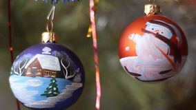 Two balls with imitation of falling snow. Christmas tree decoration. stock video