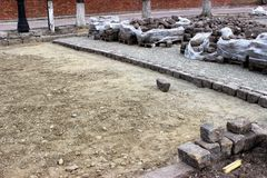 The process of replacing the old bicentennial paving stones with modern tiles. royalty free stock photo