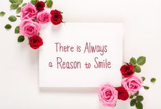There Is Alwasy A Reason to Smile message with roses and leaves. There Is Always A Reason to Smile message with roses and leaves top view flat lay Royalty Free Stock Image