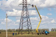 Repair of high-voltage line. There is a repair and restoration of the transmission line of high-voltage power lines. Suspend the line to the support Royalty Free Stock Photos