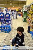 There`s a kid in a grocery cart royalty free stock photography