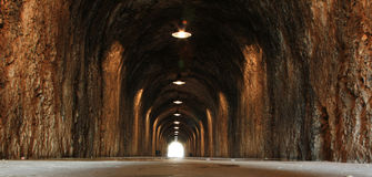 There's Light at the End of the Tunnel. Dark Tunnel with Light at the End Symbolising Hope Stock Photo