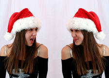 There's NO Santa?!. Brat twin shares a secret with angel twin.  There's NO Santa Stock Photo