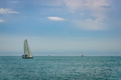 A single Sailboat is going upwond at lake constance royalty free stock image
