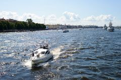 Yacht on the neva river. There are several yachts on the neva river in St.petersburg, Russia. The river is wild and deep blue. There are tourists on the yacht royalty free stock photo
