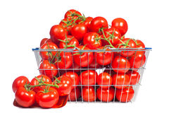There is a shopping basket full of red ripe tomatoe. Conceptual image of buying vegetables and healthy eating. Royalty Free Stock Photos