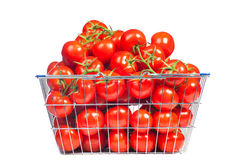 There is a shopping basket full of red ripe tomatoe. Conceptual image of buying vegetables and healthy eating. Stock Photography