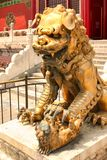 Bronze lioness guarding the entrance to the inner palace of the Forbidden City. Beijing royalty free stock photo