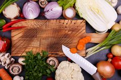 Vegetables and seeds on the wooden board royalty free stock images