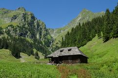 The small house in high mountains Royalty Free Stock Images