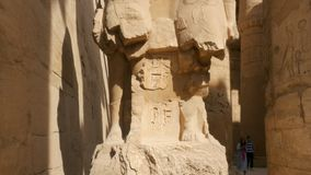 The Statue Between Stones. There is a Statue Between the Stones. the Sculpture of the Pharaoh Has Been Destroyed. the Bust and the Lower Part of the Sculpture stock footage