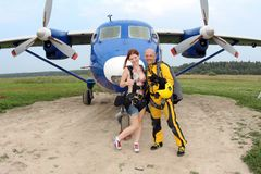 Skydiving. An Instructor and a girl are near an airplane. royalty free stock image