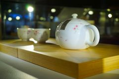 A Chinese traditional tea pot and two tea cups. There are a tea pot and two tea cups in the image. They are just art works with special design royalty free stock images