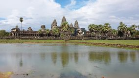 The Lake View of Angkorwat Temple. There is the temple of angkorwat, that used by monk to make ceremonial in prehistorical moment stock photography