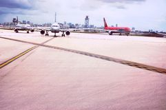 Planes three lines runways airport maiami usa stock photo