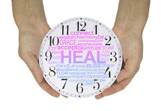 There is always time for Healing. Female hands holding a clock face containing a pink and blue graduated HEAL word cloud isolated on a white  background Stock Photos