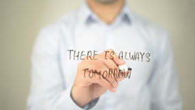 There is Always a Tomorrow, man writing on transparent screen Stock Image