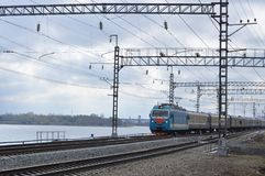 There is a train along the river. royalty free stock photography