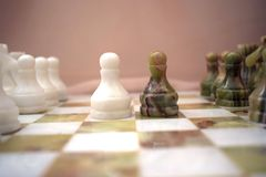 Pawns on the chessboard Royalty Free Stock Image