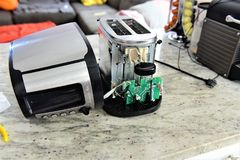 Toaster without cover repairing stock image