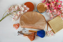 There White and Pink  Branches of Chestnut Tree,Bronze Powder;Two Make Up Brown and  Blue Brushes,Bottle Cream and Gold Box are on Stock Photography