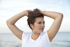 So there!. Woman holding hair in hands Stock Photography
