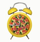 Yellow alarm clock with pizza. There is the yellow alarm clock with a pizza instead of a dial. White background stock photography