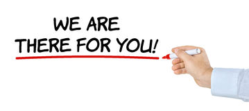We are there for you. Hand with pen writing We are there for you Stock Photo