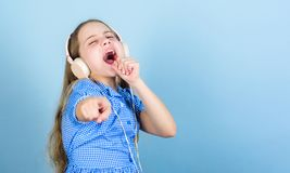 Theres a song for every emotion. Adorable amateur karaoke song singer on blue background. Cute small child doing vocal. On song. Little girl singing song royalty free stock photo