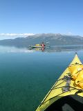 Theresa Island. Two sea kayaks in front of Theresa Island in Atlin Lake B.C. (Canada Stock Photography