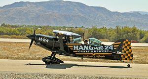 Thermal Air Show: Hanger 24 Stunt Plane. This Pitts biplane is owned and operated by the Hanger 24 craft brewery. It landed at the Jacqueline Cochran Air Port Stock Images