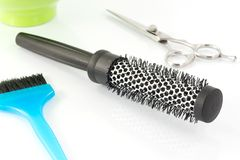 Thermal brush, scissors and brush hair dyeing Stock Photos