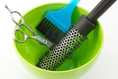 Thermal brush, scissors and brush hair dyeing Royalty Free Stock Photos