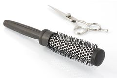 Thermal brush and scissors for hair Stock Photo