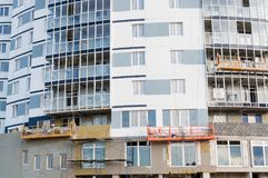 Building insulation thermal exterior. Thermal exterior insulation of a multi-storey building stock photo