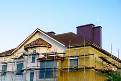 Home thermal exterior insulation. Thermal exterior insulation of an unfinished home stock images