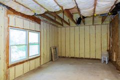 Thermal and hidro insulation with spray foam at house construction. Site Royalty Free Stock Photography