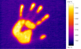 Thermal image photo, footprint hand on the wall color scale Stock Photography