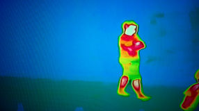 Thermal Image. Photo of a thermal image screen for background. On the screen is a thermal image of a person walking Stock Images