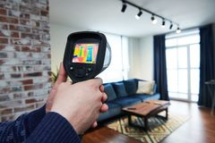 Thermal imaging camera inspection of building. check temperature. Thermal imaging camera inspection of living room in apartment for temperature loss checking royalty free stock image