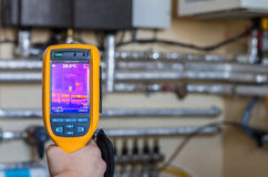 Thermal imaging inspection of heat system with tubes at house. Infrared detection of heat at tubes in the house room Stock Images