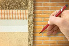 Thermal insulation coatings with hemp for building energy efficiency and reduce thermal losses against a brick wall - Building. Energy efficiency and savings royalty free stock photos